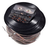 Old vintage bobbins, vinyl records and cassette tapes on a white Stock Images