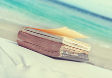 Old vintage books on the beach Royalty Free Stock Photography