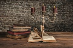 Old vintage books with candles Stock Photo