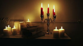 Old vintage books with candles in candlestick. stock footage