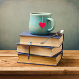 Old vintage books and cup with heart shape Royalty Free Stock Image