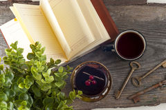 Old vintage books, cup of tea, cake and keys on rustic wooden table Royalty Free Stock Photo