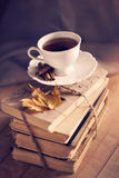 Old vintage books and cup on wooden table Royalty Free Stock Photos