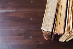 Old vintage books on dark wood background Stock Image