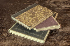 Old and vintage books on grunge wooden table Royalty Free Stock Images