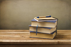 Old vintage books with note book. On wooden table Royalty Free Stock Photo