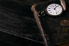 Old vintage books and a old vintage antique pocket watch Royalty Free Stock Images