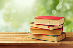 Old vintage books over bokeh background royalty free stock image