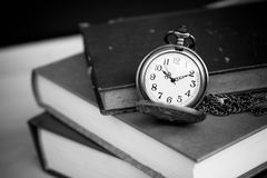 Old vintage books and pocket watches royalty free stock photos