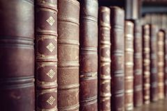 Old vintage books in a row Royalty Free Stock Image