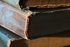 Old vintage books are stacked stock photos