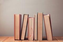 Old vintage books on wooden bookshelf stock photo