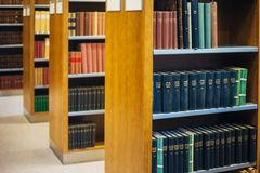 Old Vintage Books On Wooden Shelfs In Library. HELSINKI, FINLAND - JULY 28, 2014: Old Russian Vintage Books On A Shelfs In The National Library of Finland Royalty Free Stock Photography