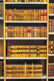 Old Vintage Books On Wooden Shelfs In Library Stock Photos