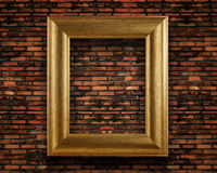 Old vintage brick wall with golden frame stock photos