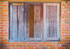 Old vintage brick wall and wooden window Royalty Free Stock Photo