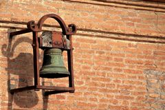 Old vintage bronze bell on the roof stock image