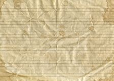 Old vintage brown crumpled paper in a ruler with splashes and blots royalty free stock photography