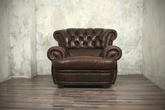 Old vintage brown leather chair Stock Images