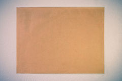 Old vintage  brown paper on white wall background. - (Split tone) Stock Image