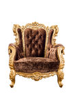 Old vintage brown velvet classic armchair with gold color isolat Stock Images