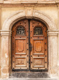 Old vintage building entrance door. Made of wood with metal enhancements royalty free stock image