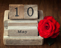Old vintage calender showing the date 10th of May. Which is the date of Mothers day in United States with a red rose Stock Image