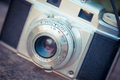 Old vintage camera. The beautiful design of an old vintage camera with analogic film Royalty Free Stock Photos