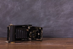 Old vintage camera against a blackboard background Stock Photography