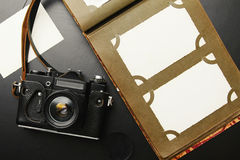 Old vintage camera with album Royalty Free Stock Photography