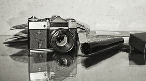 Old vintage camera with albums on the table. Stock Photography