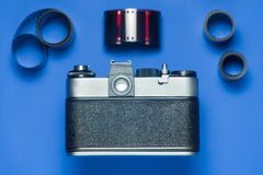 Old vintage camera on a blue background. Back view. stock images