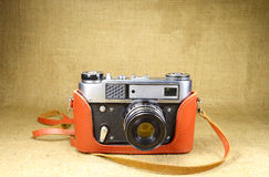 Old vintage camera closeup on canvas Royalty Free Stock Image