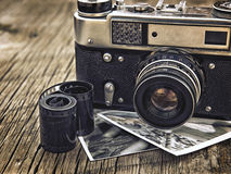 Old vintage camera closeup on wooden background Stock Photography