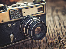 Old vintage camera closeup on wooden background Royalty Free Stock Photography