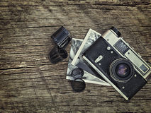 Old vintage camera closeup on wooden background stock image