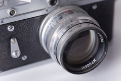 Old vintage camera with dust, soft focus. Vintage camera, focus on lenses stock photography