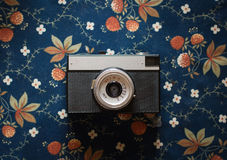 Old vintage camera on a  fabric background. Old vintage camera on a vintage fabric background Royalty Free Stock Photography