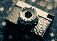 Old vintage camera on a  fabric background. Old vintage camera on a vintage fabric background Royalty Free Stock Images