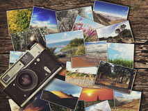 Old vintage camera and photos on a wooden background Royalty Free Stock Image