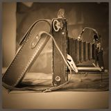 Old vintage camera on a sepia still Royalty Free Stock Photos
