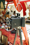 Old vintage camera on a tripod. Close up Royalty Free Stock Image