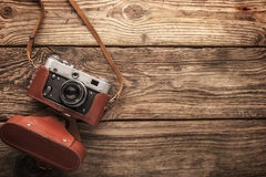 Old vintage camera on the wooden background horizontal Royalty Free Stock Photography