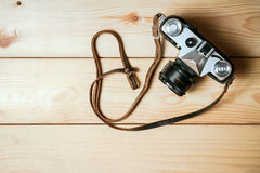Old vintage camera on a wooden floor Stock Photo