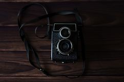 Old vintage camera on a wooden table. Royalty Free Stock Photo