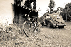 Old vintage car and bicycle in the village Stock Photo