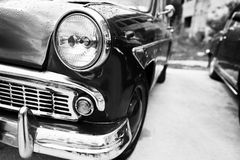 Old vintage car headlight close up. Black and white photo Stock Photo