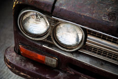 Old, vintage car headlight close-up. Shabby, rough antique trans Stock Photo
