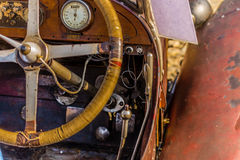 Old vintage car. The steering, the control panel, the accelerator pedal, brake and clutch lever in an old vintage car Stock Images