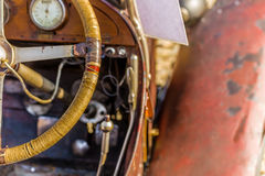 Old vintage car. The steering, the control panel, the accelerator pedal, brake and clutch lever in an old vintage car Stock Photo